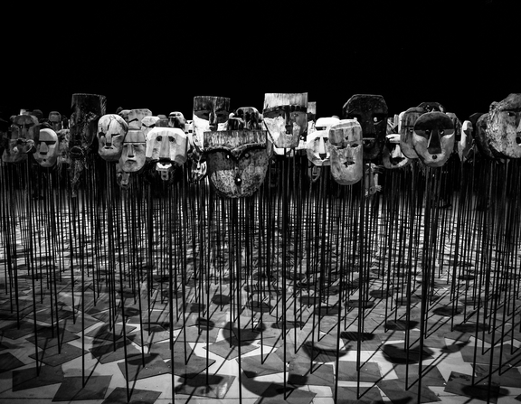 Large canva   greyscale photo of masks on a stick